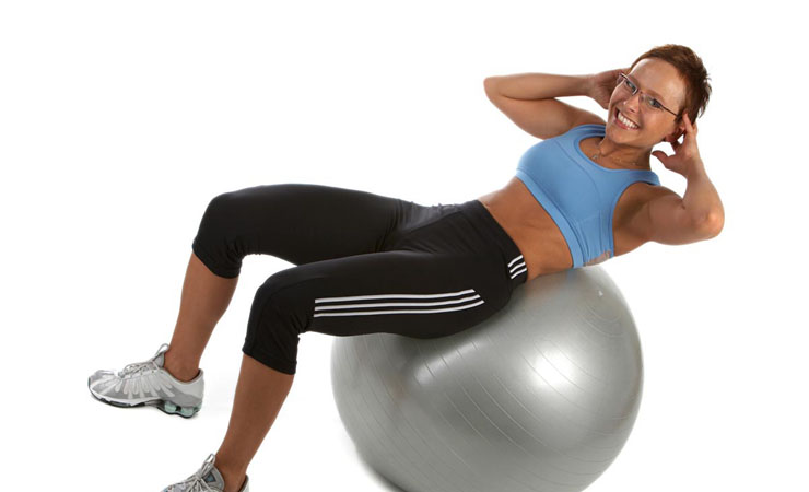 CRUNCHES USING EXERCISE BALL